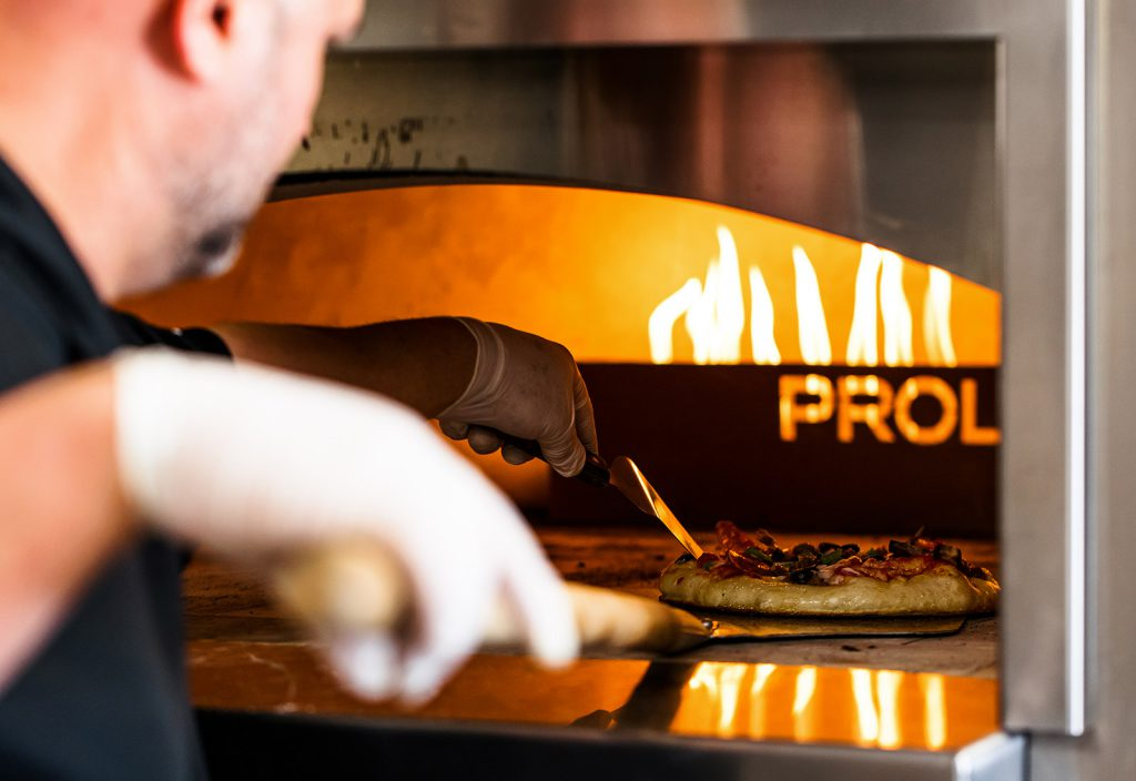 Why the Stone Hearth Makes Our Pizza So Good image
